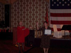 Lisa Michael accepting certificate from SgtMaj (ret) Pam Bloustine