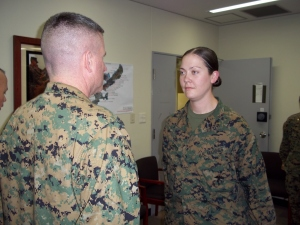 1stLt Catherine Carty reports to Col Andrew MacMannis, Commanding Officer, 31st Marine Expeditionary Unit, during her recent promotion ceremony