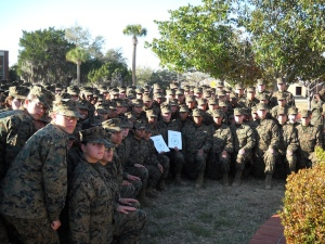 Women Marines of Platoons 4004 and 4005 take a knee for a photo with their Molly Marines.