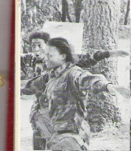 Marine Cpl Sabrina (Williams) Messenger (left), expresses her surprise and bewilderment as she exits the gas chamber during Marine Corps boot camp in 1979.